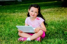 The Little Girl With The Laptop Stock Image