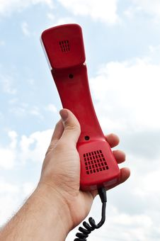 Free Man Holding A Red Phone Stock Photo - 21144480