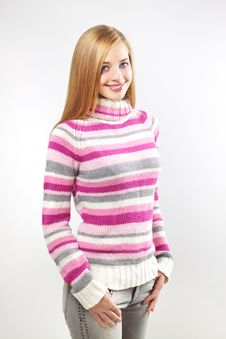 Portrait Of Pretty Girl Wearing Sweater. On Gray Royalty Free Stock Image