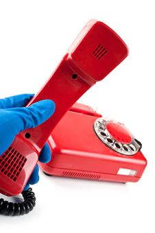 Free Man In Blue Gloves Picked It Up The Red Phone Stock Photo - 21145070