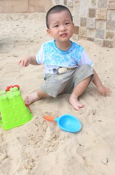 Free Boy Play On Sand Stock Photo - 21148360
