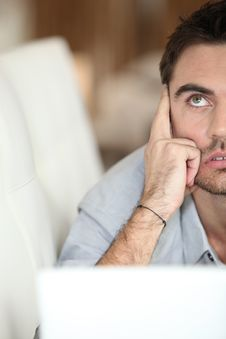 Free A Man Looking Up Behind A Laptop Royalty Free Stock Photography - 21148687