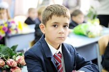 Free Portrait Of First-grader Boy Sitting At His Desk Royalty Free Stock Photography - 21148857