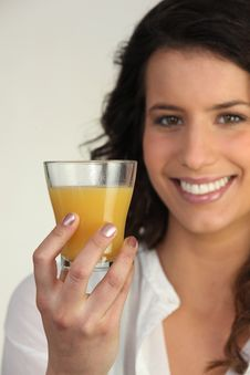 Free Woman Holding A Glass Of Orange Juice Royalty Free Stock Photo - 21148925