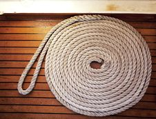 Free Rope Coil Across Teak Decking Royalty Free Stock Photos - 21149158
