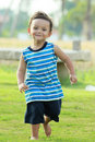 Free Active Young Boy Smiling And Running Stock Image - 21157481