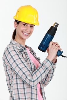 Free Woman Holding Electric Heater Stock Photography - 21150662
