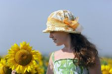 The Little Girl And Sunflowers Stock Photo