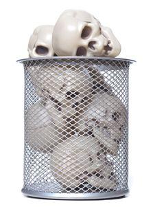 Human Skulls In A Wastebasket Royalty Free Stock Image