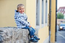 Free Little Boy Sits Near The Old House Royalty Free Stock Photos - 21155548