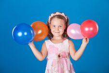 Free Happy Child With Colorful Air Ballons Over Blue Stock Image - 21158631