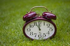 Free Clock On A Grass Stock Images - 21158784