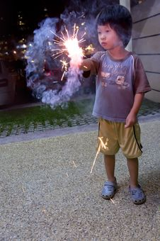 Boy With Fire Crackers Stock Image
