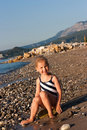 Free Beautiful Girl Sitting On A Beach Stock Photography - 21163772