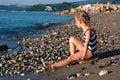 Free Beautiful Girl Sitting On A Beach Royalty Free Stock Photo - 21163815