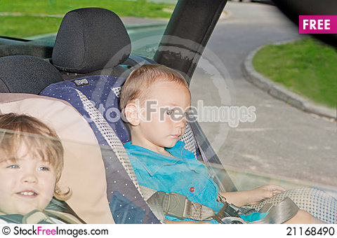 Free Two Little Kids On Back Seat In Child Safety Seat Stock Photo - 21168490