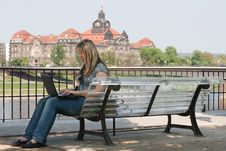 Free Girl With Laptop In Dresden On The Bank Of The Elb Royalty Free Stock Photography - 21160037