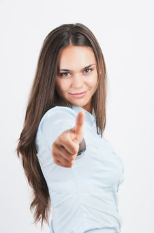 Casual Woman Smiling With Her Thumbs Up Stock Image