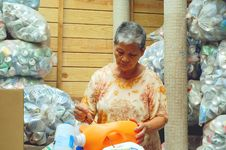 Free Sorting Recyclables Old Woman Stock Image - 21161911