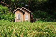 Cabin In Forest Stock Images