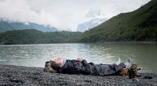 Free Man Resting By Lake Mountain Royalty Free Stock Images - 21163739