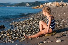 Free Beautiful Girl Sitting On A Beach Royalty Free Stock Photo - 21163815