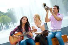 Free Young Friends Play The Guitar And Trumpet Stock Photo - 21166740