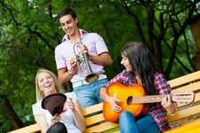 Free Young Friends Play The Guitar And Trumpet Stock Image - 21166741