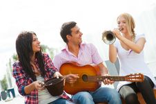 Free Young Friends Play The Guitar And Trumpet Royalty Free Stock Photo - 21166745