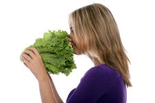 Free Young Woman Smelling Lettuce Close Up Royalty Free Stock Photography - 21169097
