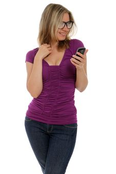 Flirty Woman Holding Cell Phone Stock Photography