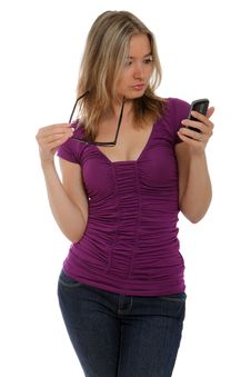 Free Serious Woman Holding Cell Phone And Glasses Stock Images - 21169394