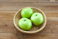 Free 3 Green Apples On Basket With Teak Wood Background Stock Image - 21169921