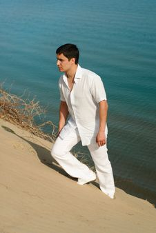 Free The Guy In White On The Beach Royalty Free Stock Photos - 21171688