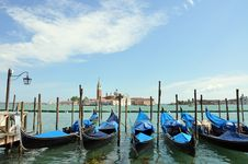 Anchored Gondolas At Sunny Day Royalty Free Stock Images