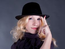 Portrait Of A Beautiful Young Blonde Woman In Hat Stock Photo