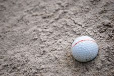 Golf Ball On Sand Royalty Free Stock Images