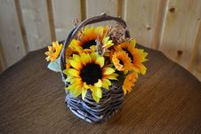 Man-made Bouquet Of Sunflowers In A Basket Stock Photography
