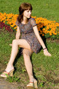 Free Beautiful Girl Sitting On Meadow Royalty Free Stock Photography - 21186907