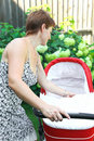 Free Beautiful Woman Looking In Baby Stroller Stock Photo - 21187550
