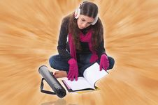Young Female Student Sitting On Floor Studying Stock Image