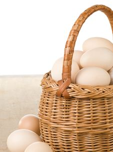 Eggs And Basket On White Stock Photography