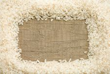 Free Rice Grain On Wood Background Royalty Free Stock Photos - 21182068