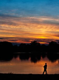 Free Fisherman At Sunset Royalty Free Stock Photography - 21182717