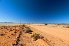 Free Road Through A Vast, Arid Landscape Royalty Free Stock Photography - 21183887
