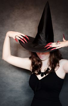 Free Witch With Black Hat And Long Nails Stock Image - 21185401