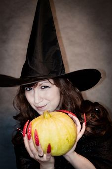 Free Witch With Pumpkin In Hands Stock Photo - 21185430