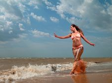 Free Woman In Exotic Dress Standing On The Beach Stock Photo - 21186030