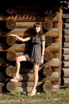 Free Beautiful Girl Standing Near Wooden House Royalty Free Stock Photo - 21186835