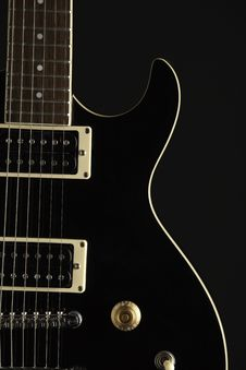 Free Black Electric Guitar On Black Royalty Free Stock Photos - 21187268